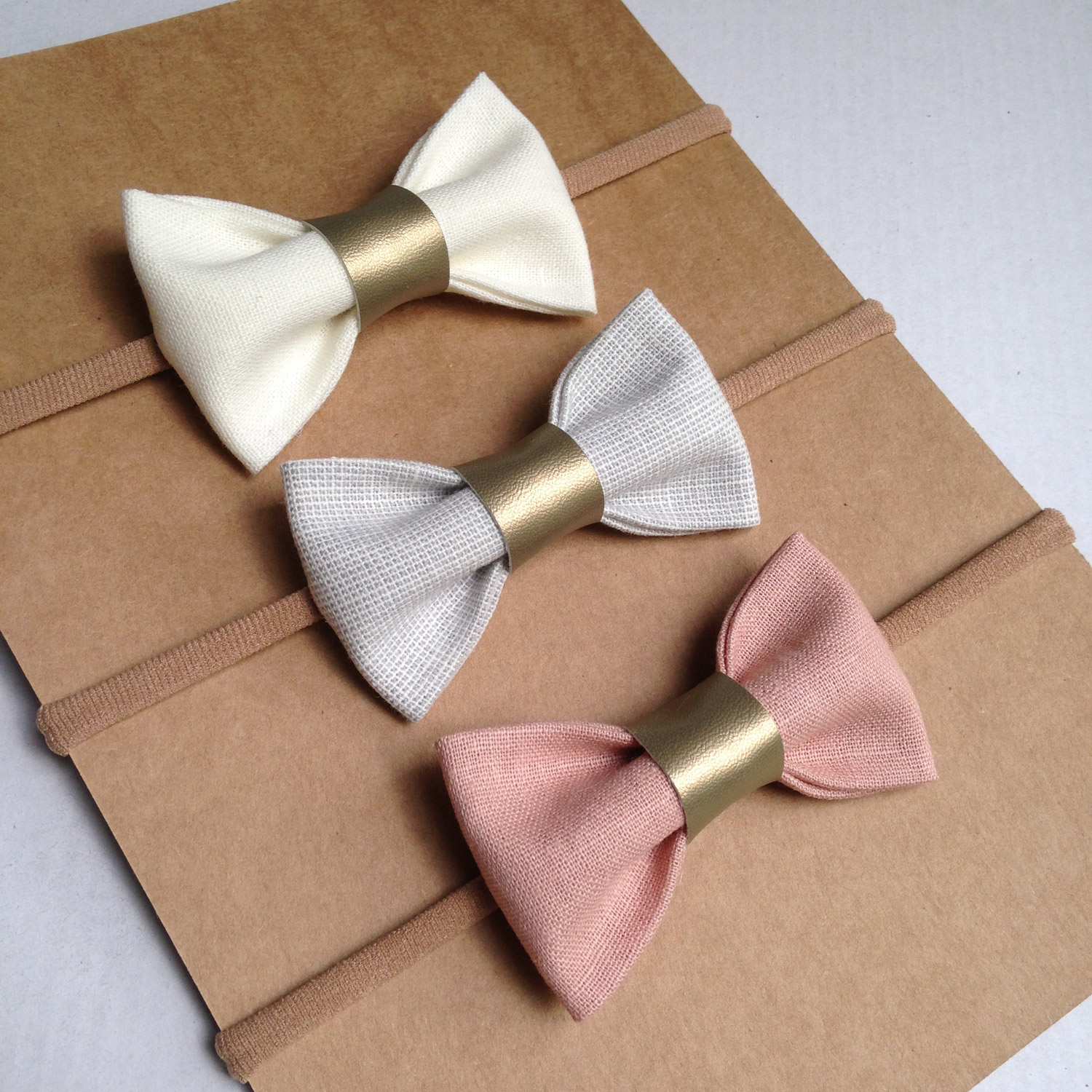 gold faux leather detail bows